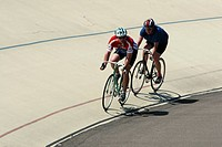 Cyclists Racing In A Velodrome