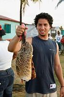 Tasbapauni, Nicaragua, Man holding turtle flippers