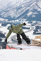 Young Boy Snowboarding
