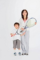 Mother and son posing with badminton
