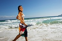 Woman running at beach
