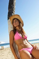 Woman in cowboy hat at beach (thumbnail)