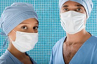 Close_up of a male surgeon and a female surgeon