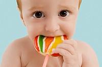 Portrait of a boy licking a lollipop