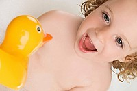 Close_up of a girl with a rubber duck