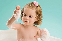 Close_up of a girl bathing in a bathtub