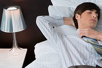 Businessman sleeping on the bed
