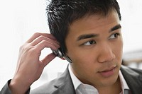 Close-up of a businessman wearing a hands free device (thumbnail)