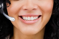 Close_up of a customer service representative smiling