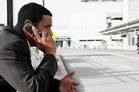 Side profile of a businessman talking on a mobile phone