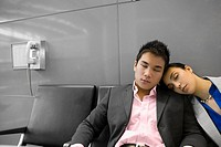 Businessman and a businessman sleeping in the waiting room