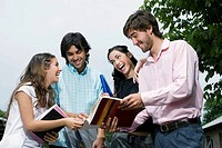 University students discussing and smiling