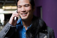 Young man talking on a mobile phone and smiling (thumbnail)