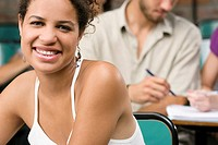 Close_up of two university students sitting in a classroom