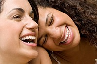 Close_up of two university students laughing
