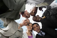 Low angle view of business executives standing in a huddle
