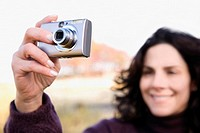 Close_up of a mature woman photographing with a digital camera