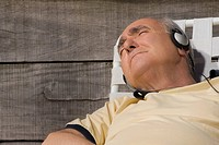 Close_up of a senior man listening to music
