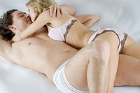 High angle view of a young couple romancing on the bed