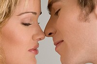 Close_up of a young couple romancing