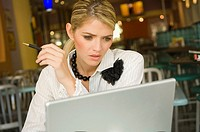 Businesswoman using a laptop in a restaurant