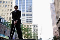 Low angle view of a businessman playing golf