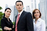 Portrait of a businessman and two businesswomen