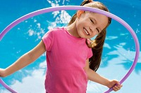 Portrait of a girl holding a plastic hoop and smiling