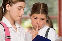 Close-up of two schoolgirls looking at a textbook (thumbnail)