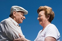Side profile of a senior couple holding each other and smiling