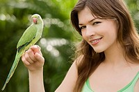 Parrot on a young woman's hand (thumbnail)