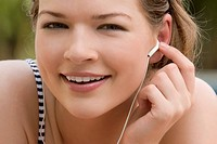Close_up of a young woman listening to music