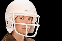Close_up of a businesswoman wearing a football helmet
