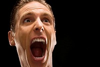 Close-up of a businessman shouting (thumbnail)
