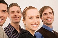 Portrait of four business executives smiling