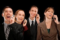 Business executives talking on mobile phones and smiling (thumbnail)