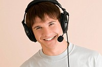 Portrait of a young man listening to music (thumbnail)