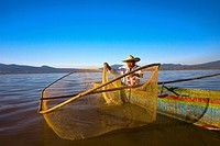 Fisherman with butterfly fishing net in a lake, Janitzio Island, Lake Patzcuaro, Patzcuaro, Michoacan State, Mexico