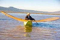 Fisherman with butterfly fishing net in a lake, Janitzio Island, Lake Patzcuaro, Patzcuaro (thumbnail)