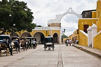 Horse carts in front of a church, Convento De San Antonio De Padua, Izamal, Yucatan, Mexico