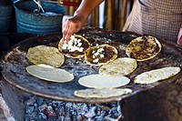 Chef preparing tortilla in a kitchen, Santo Tomas Jalieza, Oaxaca State, Mexico