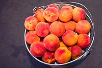 Close_up of a bucket of peaches, Zacatecas, Mexico