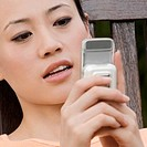 Close-up of a young woman using a mobile phone (thumbnail)