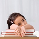 Close_up of a girl leaning on books
