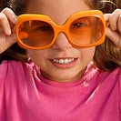 Close_up of a girl wearing an oversized sunglasses