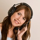 Portrait of a young woman listening to music