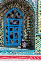 Pilgrim sits in a niche at the Shrine of Hazrat Ali, who was assassinated in 661, Mazar_I_Sharif, Afghanistan, Asia