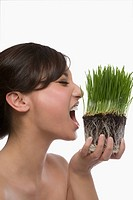 Close_up of a young woman eating wheatgrass