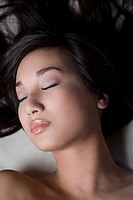 Close_up of a young woman sleeping on a massage table