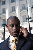 Portrait of a businessman talking on a mobile phone (thumbnail)
